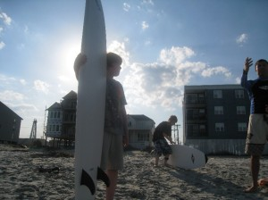 Eric, his surfboard, and sunset. (Anne Helmenstine)